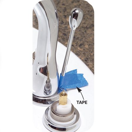 """<b>Photo 14: Lock the stopper in position</b></br> The pop-up stopper will be in the raised position most of the time, so with the stopper """"up,"""" choose the best-looking position for the handle and tape it there as you adjust the metal strap."""