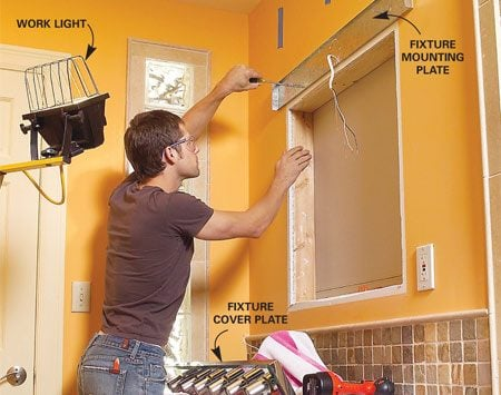 <b>Photo 3: Remove the old light fixture</b></br> Remove the decorative light cover, then disconnect the wire connectors, loosen any wire clamps and unscrew the mounting plate from the wall.