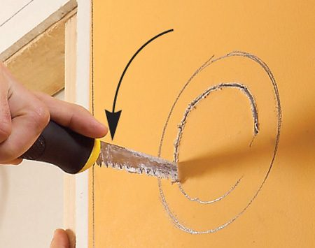 <b>Cut a hole for the electrical box </b></br> Use a drywall saw to cut the opening for the electrical box