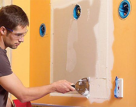 <b>Photo 9: Patch the drywall</b></br> Screw a drywall patch over the opening, then tape, sand and paint the patch.