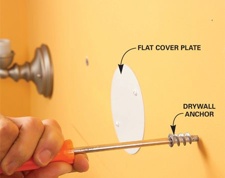 <b>Photo 11: Use anchors to mount the mirror</b></br> Screw anchors into the drywall at each mark, then drive in screws, stopping when the heads are 1/4 in. from the wall.