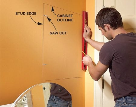 <b>Photo 1: Mark the opening</b></br> Outline the inset medicine chest to fall against a stud on one side and cut out the opening with a drywall saw.