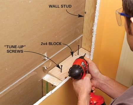 <b>Photo 3: Add wood blocking</b></br> Screw blocking to adjacent studs at the top and bottom of the opening. Predrill when toe-screwing.
