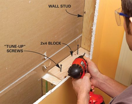<b>Photo 3: Add wood blocking</b><br/>Screw blocking to adjacent studs at the top and bottom of the opening. Predrill when toe-screwing.