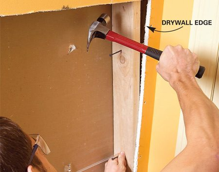 <b>Photo 4: Add backing to support drywall</b></br> Cut and tap in vertical backing flush with the drywall edge, then toe-screw it to the blocking.