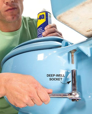 <b>Photo 1: The deep-well socket option</b></br> Unscrew nuts on metal toilet seat bolts with a deep-well socket. Apply penetrating lubricant to help free corroded nuts.