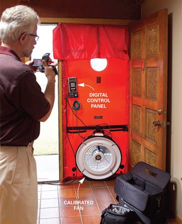 <b>Photo 3: Blower door test</b></br> With all doors and windows closed, the auditor inserts a blower door in the front or back doorway and starts the fan.
