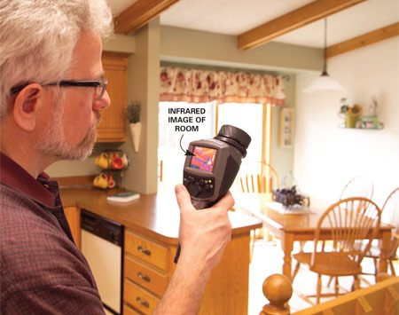 <b>Photo 5: Thermography</b></br> The auditor uses an infrared camera to scan walls and ceilings. The camera detects temperature differences and can pinpoint cold spots and air leaks.