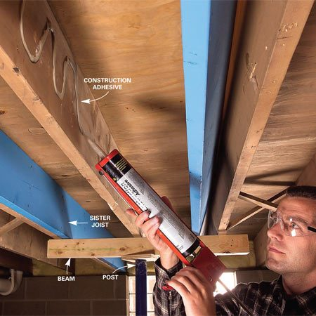 <b>Spread adhesive on the joist</b></br> Apply ample construction adhesive to the existing joist