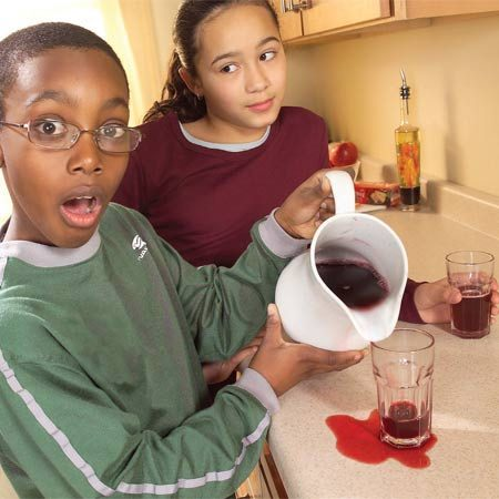 <b>Photo 1: Apply a baking soda paste to the stain</b></br> Mix baking soda with just enough water to form a thick paste. Apply the paste to the stain and lay a wet paper towel over the paste to keep it moist.