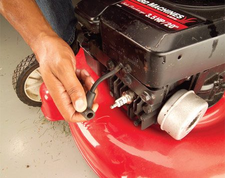 <b>Photo 1: Remove spark plug	</b></br> Pull the spark plug wire from the spark plug to prevent the motor from accidentally starting. Tape or tie it back so it doesn't flop back into contact with the plug.