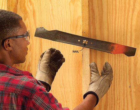 <b>Photo 5: Check blade balance</b></br> Hang the blade on a nail to check the balance. If one side dips, file a bit more off that side until the blade remains horizontal.