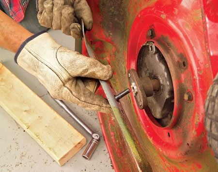 <b>Photo 6: Reinstall the blade</b></br> Reinstall the blade and screw in the bolt. Then wedge the 2x4 back in and tighten the bolt firmly with your socket and breaker bar.