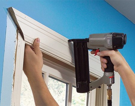 <b>Photo 5: Reinstall the trim</b></br> Tack each section of trim exactly in its original position with a couple of nails. Ridges in the wall paint can help you align each piece perfectly. Make sure the parts fit together tightly at the corners before you add more nails.