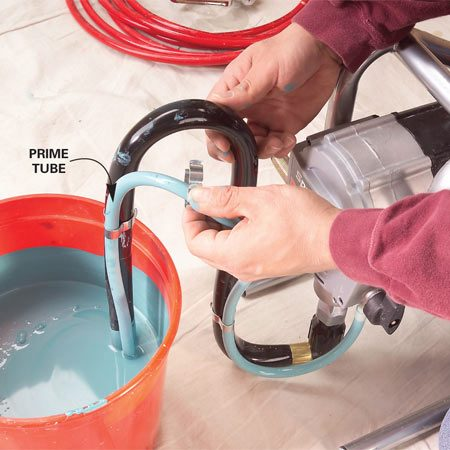 <b>Photo 2: Clear air bubbles</b></br> Clip the prime tube to the suction tube. Let the pump run for about 30 seconds or until no more air bubbles come out of the tube.