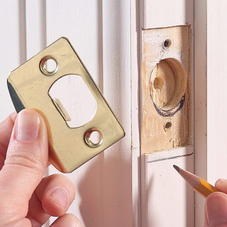 <b>Close-up</b></br> You may also have to enlarge the latch hole in the jamb.