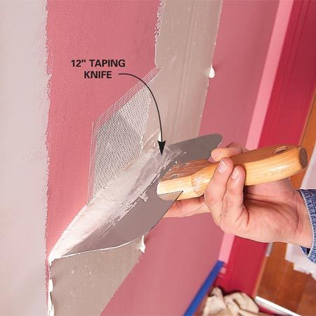 <b>Photo 2: Apply drywall compound</b></br> Apply two thin coats of drywall mud. Then sand when dry.