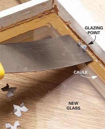 <b>Photo 2: Set the glass in place</b></br> Set new glass onto a bead of latex caulk. Press glazing points into the wood every 8 in. Let the excess caulk that oozes out under the glass harden and slice it off with a utility knife later.