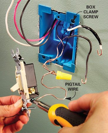 <b>Photo 4: Attach the wires to the switch</b></br> Clamp the first electrical box to the wall. Connect a three-way switch, the ground wires and all other wires following Figure B.