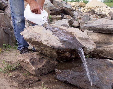 <b>Test the water flow</b></br> Bring water from home and pour it over the stone you choose to test the water flow.