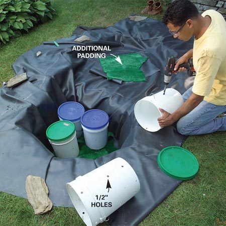 <b>Photo 5: Drill holes in the buckets and set them in the hole</b><br/>Drill four columns of 1/2-in. holes around the middle and near the bottom and top of each pail. Then snap on the lids and rest the pails in the hole.