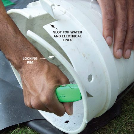 <b>Photo 6: Cut the rim off the bucket</b><br/>Cut off the rim from the pump pail and cut and fold down a 1-1/2-in.-wide x 2-in. flap at the top for the water line and electrical cable.