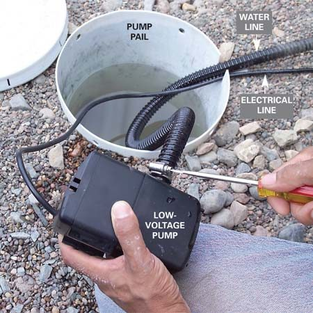 <b>Photo 8: Attach the water line to the pump</b></br> Connect the water line to the pump and route it to the stone fountain location, avoiding areas where heavy stones will rest.