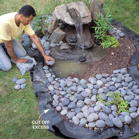 <b>Photo 13: Decorate the fountain</b></br> Scoop out the pea gravel and set in potted pond plants, then finish the water feature with decorative topdressing and perimeter edging stones.