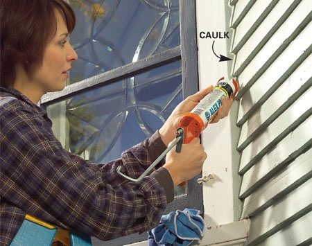 <b>Photo 4: Caulk gaps between trim and siding</b><br/>Fill gaps between trim and siding with acrylic latex caulk. Keep a wet cloth handy to clean up any stray caulk. Smooth the bead with a wet finger.