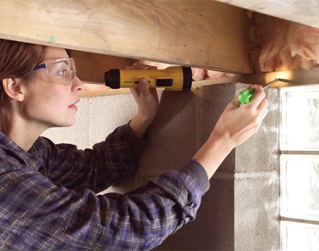 <b>Photo 2: Probe for rotten wood</b><br/>If you suspect an area is damp, use a screwdriver to probe the wood to determine if it&#39;s soft and moist. Eliminate the moisture source and replace rotten wood.