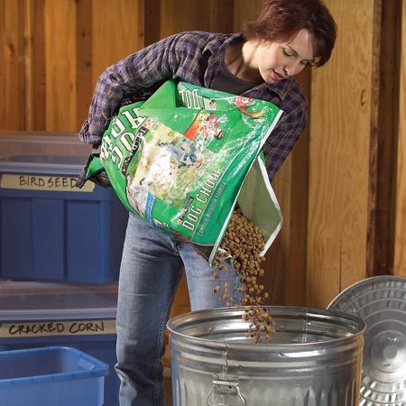 <b>Photo 1: Store pet food</b><br/>Store pet food in a lidded metal trashcan, as mice cannot climb the slick, vertical sides of the can. Sealed plastic containers are also a good option.