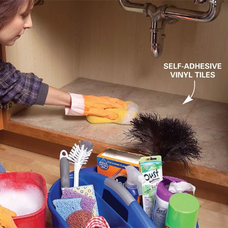 <b>PHOTO 2: Consolidate under-sink clutter</b><br/><p>Tidy up under the kitchen sink. Store items in a caddy so you can easily clear out the cabinet for cleaning and inspection. Self-adhesive tiles provide an easy-to-clean surface.</p>