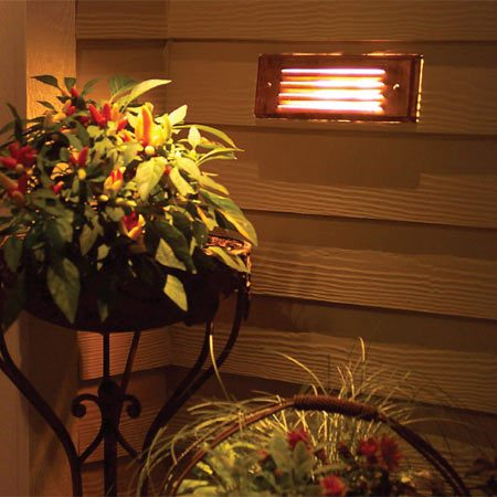 <b>B: Recessed 12-volt lights</b></br> Recessed 12-volt lights diffuse the light for soft general lighting. You'll need a hollow area like our deck planter or stair riser to mount this type of fixture. They are not to be mounted in an exterior wall of the house.