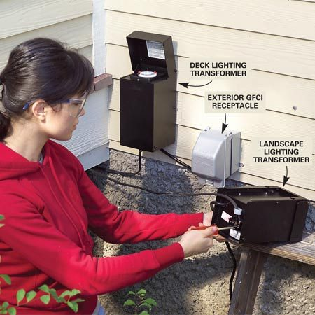 <b>Photo 1: Transformer</b></br> Mount the transformers near the exterior receptacle. Leave enough cable to connect to each transformer later. You can connect to the transformers once you've wired the circuit.