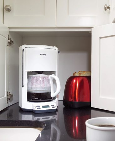 <b>The ever useful appliance garage</b></br> A corner appliance cabinet hides coffeemakers, toasters and other small appliances while making efficient use of often-wasted corner space.