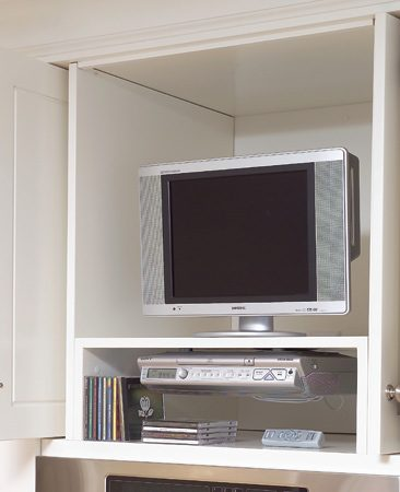 <b>Media cabinet</b></br> A media cabinet holds a TV, a DVD player and DVDs. Flipper doors swing open, then glide back into the sides of the cabinet to provide an unobstructed view.