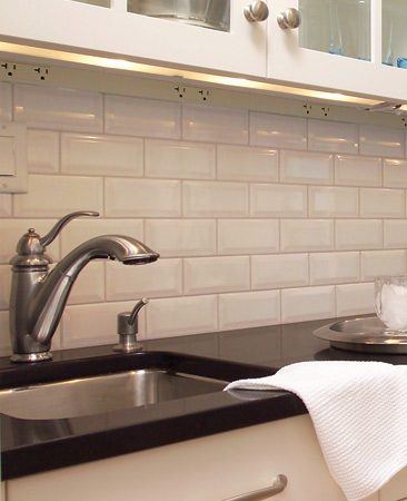 <b>Space-saving detail: Hidden outlets, handy location</b></br> Continuous electrical strips with outlets spaced every 12 in. are positioned along the back lower edge of the wall cabinets. A valance built into the cabinets helps hide the strips—and the undercabinet lighting—from view, and the close spacing provides power for small appliances wherever they're used.