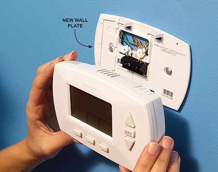 <b>Photo 4: Mount the thermostat</b></br> Install the batteries, program the thermostat and snap it onto the wall plate.