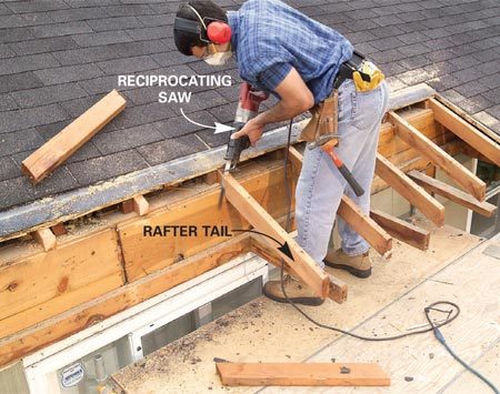 <b>Photo 4: Cut away the roof</b></br> Mark the roof portion that overhangs the deck. Then cut the roof sheathing back even to the edge of the house and pry it off. Cut the rafter tails off flush with the house wall.