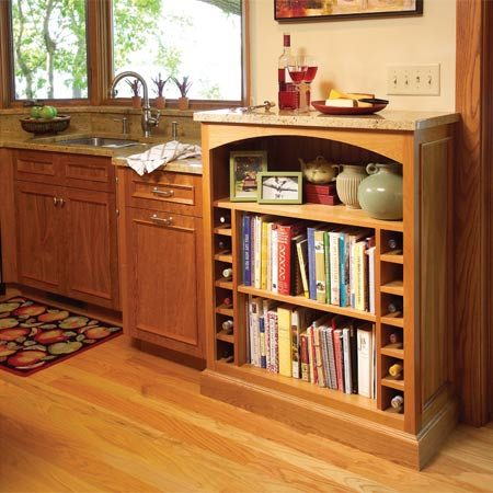 <b>Multiuse built-in cabinet</b></br> This built-in cabinet has the look of a freestanding bookcase and provides convenient storage for wine, cookbooks and collectibles. The granite top allows it to do double duty as a server.