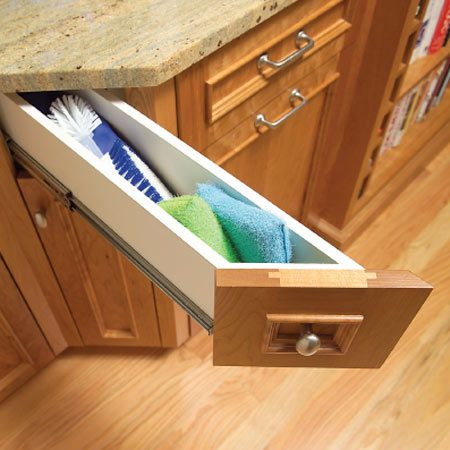 <b>Angled drawer</b></br> This uniquely designed drawer saves a few inches that might otherwise be wasted. It makes a perfect storage nook for scrubbers and sponges where you need them most—next to the sink.