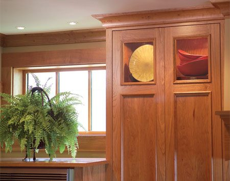 <b>Windows and cabinet lighting</b></br> This window positioned above the double ovens helps balance the light. Recessed, under-cabinet and in-cabinet lighting keeps the kitchen well illuminated and spacious feeling.