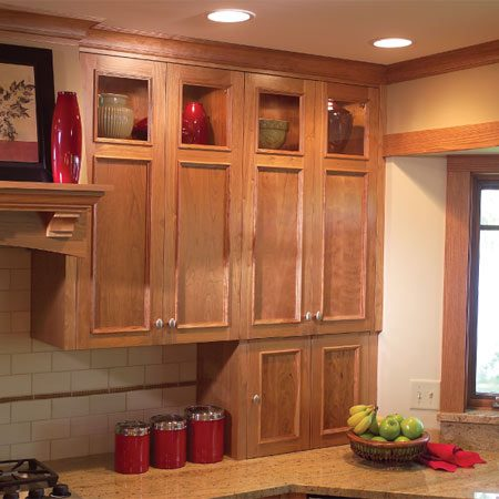 <b>Appliance garage and glass cabinet doors</b></br> An appliance garage provides hidden space for often-used items like mixers, toasters and coffeemakers. Glass-front uppers provide display space for collectibles.