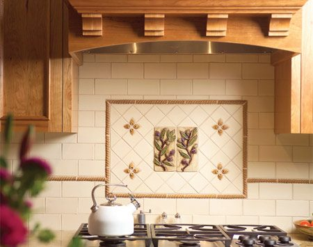 <b>Bright focal point</b></br> This tile mural provides a focal point for the cooktop area as well as for the rest of the kitchen.