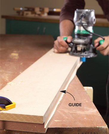 <b>Photo 1: Use a straight guide</b></br> Run a pattern bit along a guide to cut a straight edge. For thick boards, remove the guide after the first pass.