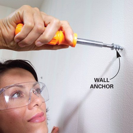 <b>Photo 4: Drive anchors</b></br> Drive a wall anchor into the drywall at each hook location.