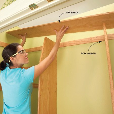 <b>Photo 7: Nail the top shelf in place</b></br> Trim the top shelf ends to fit the side walls, drop the shelf into place, and nail it to the tops of the vertical dividers and to the hook strip with 6d nails.