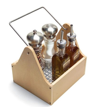 <b>Photo 1: Cooking caddy</b></br> You always want salt, cooking oils and your favorite spices next to the stove because you use them every day. But they don't have to take up valuable counter space full time. Place them all in a caddy that you can instantly stow in a cabinet after cooking. You'll find caddies in various shapes, sizes and prices at any store that sells kitchenware.