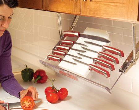<b>Photo 3: Knife storage rack</b><br/>Pull-down racks give you instant access to kitchen essentials without the clutter of spice racks or knife holders. When the cooking is done, the rack swings up against the underside of the cabinet. The acrylic knife rack like the one shown here, or buy a pair of hinges only and make your own wooden rack to hold knives, spices or other small items that take up counter space.