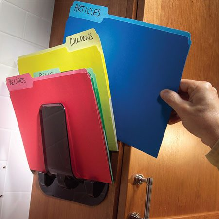 <b>Photo 6: Organized files</b></br> Countertops are a landing pad for paper—mail, news clippings and other assorted notes. Get that mess off your counter with folders and a file holder. The one shown here (from an office supply store) mounts with screws or double-sided foam tape. If you don't have suitable vertical surface, get a file holder that sits on the countertop. It will take up less space (and look neater) than a stack of papers.
